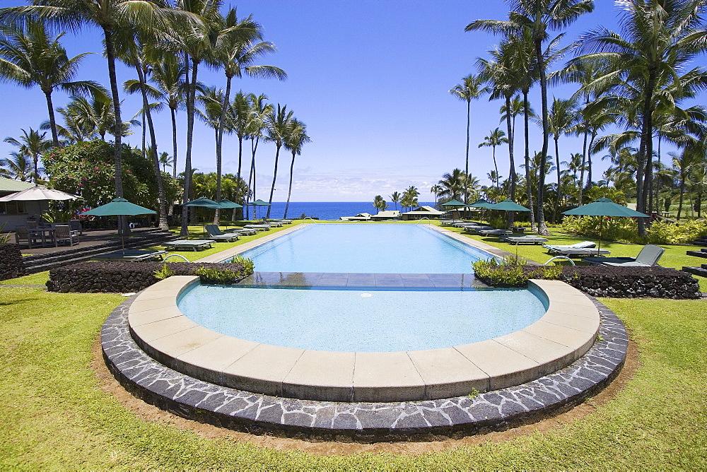 Hawaii, Maui, Hana Coast, Swimming pool at the Sea Ranch Cottages at Hotel Hana.