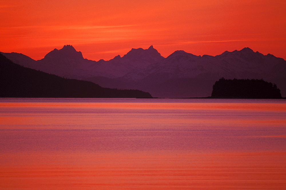 Alaska, Favorite Channel, Lynn Canal, Chilkat mountains. Sunset over the water.
