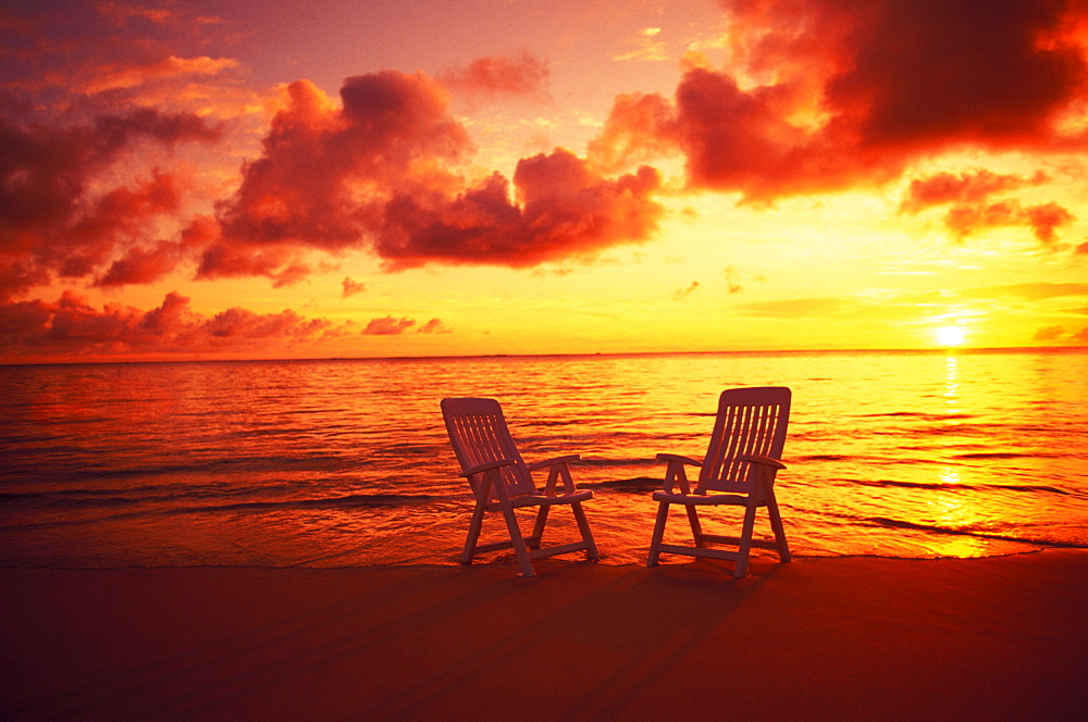 Hawaii, Oahu, Lanikai beach at sunrise with beach chairs in shoreline water