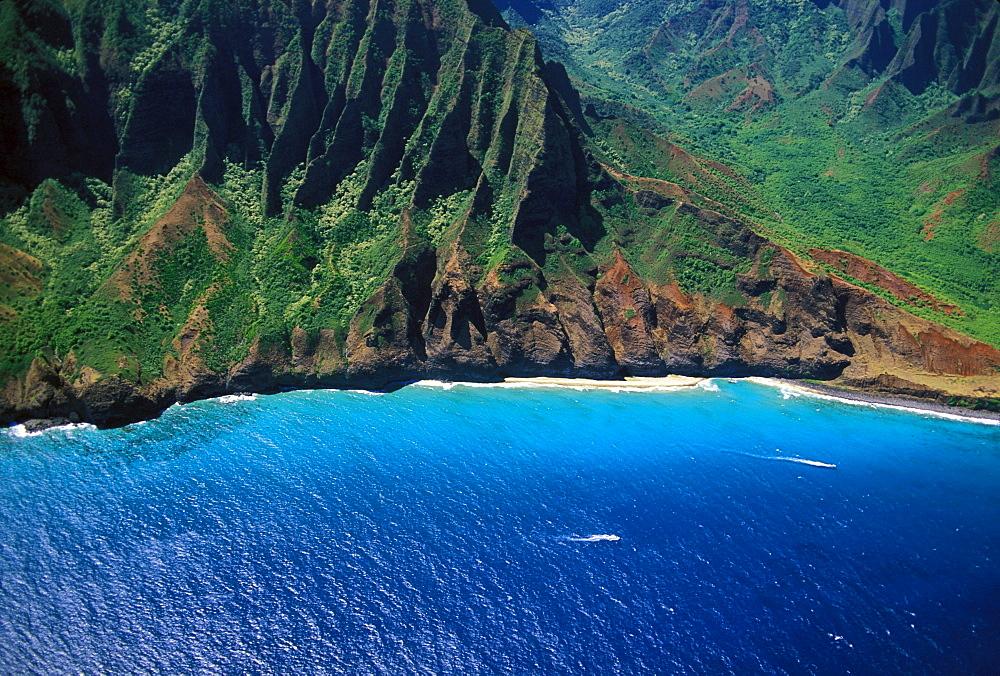Hawaii, Kauai, Aerial of Na Pali Coast, cliffs, beach, ocean.