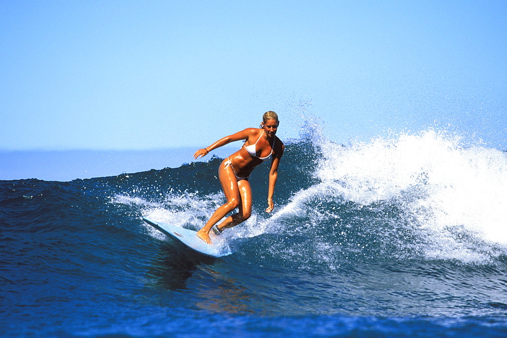 Surfer girl, Jessica Bishop riding a wave
