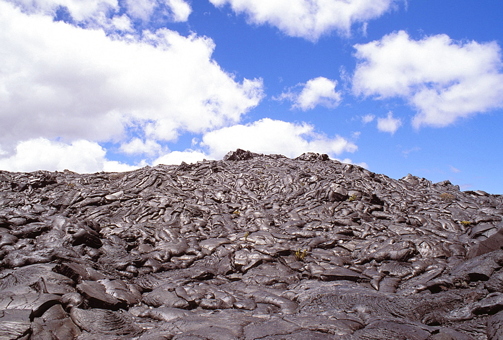 Hawaii, Big Island, Saddle Road, Pahoehoe lava field, blue skies, clouds