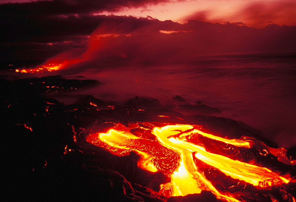 Hawaii, Big Island, Hawaii Volcanoes National Park, lava flow glows in early dawn