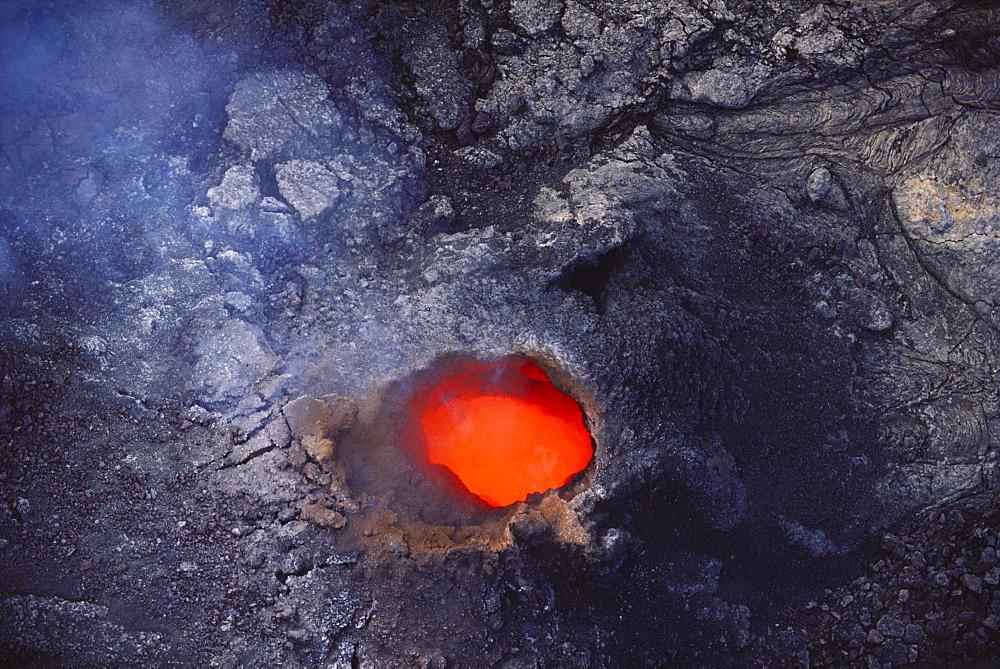 Hawaii, Big Island, Hawaii Volcanoes National Park, Molten lava seen through hole in lava tube.
