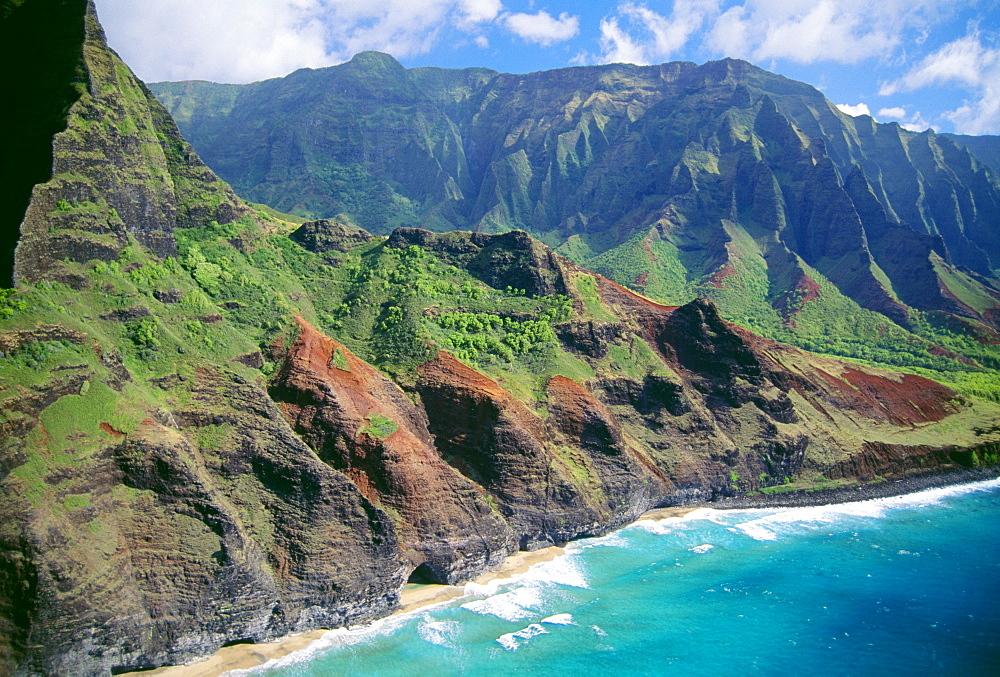 Hawaii, Kauai, Napali Coast, aerial along dramatic cliffs ocean and beaches