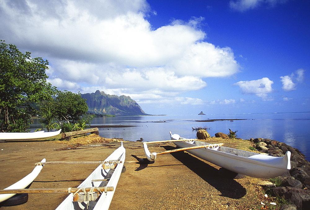 Hawaii, Oahu, Waiahole, outrigger canoes on beach, turquoise water