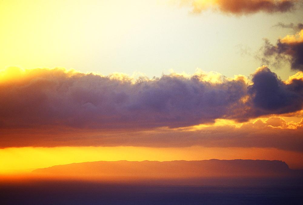 Hawaii, Sunset over Niihau, from Kauai, golden sky