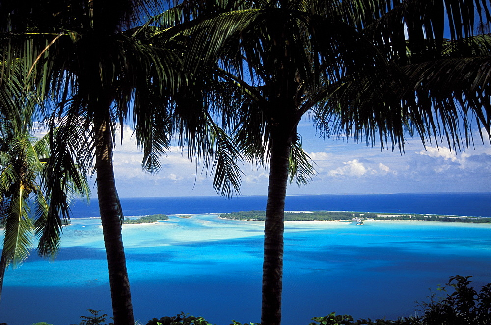 French Polynesia, Bora Bora, View from shore of lagoon and sand islands in distance.