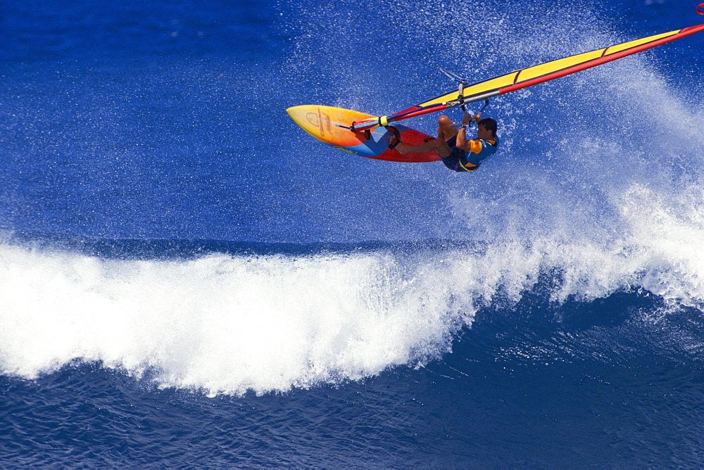 Hawaii, Pete Cabrina jumps wave, windsurfing contest