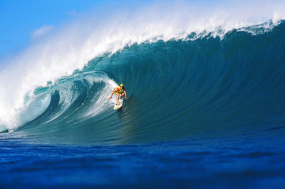 Hawaii, Oahu, Liam (surfer) surfing Pipeline wave.