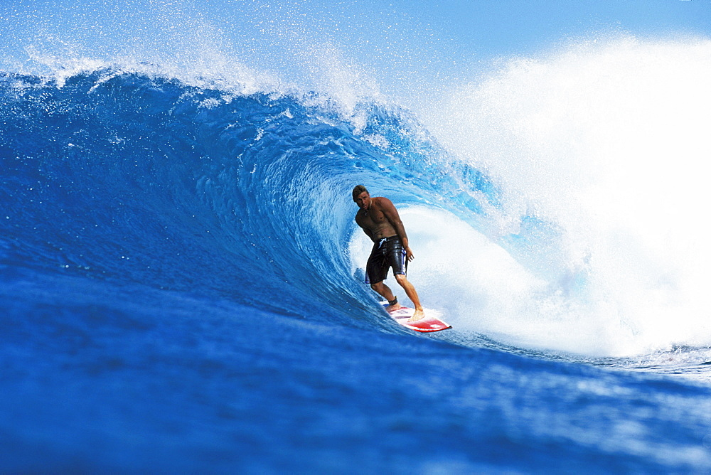 Hawaii, Oahu, North Shore, Backdoor Pancho stands inside wave curl