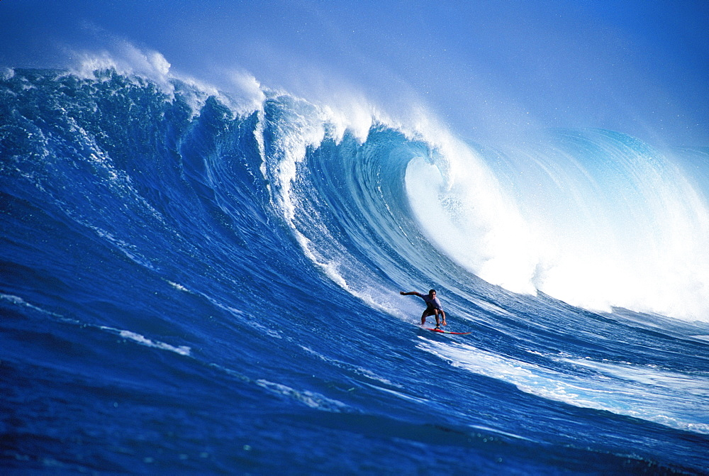 Hawaii, Maui, Peahi, Buzzy Kerbox surfing big wave curling and crashing behind