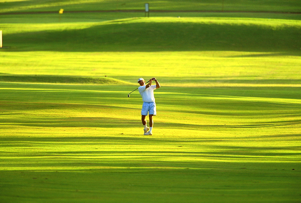 Hawaii, Maui, Spreckelsville Country Club, front view of Jim Bendon hits fairway iron