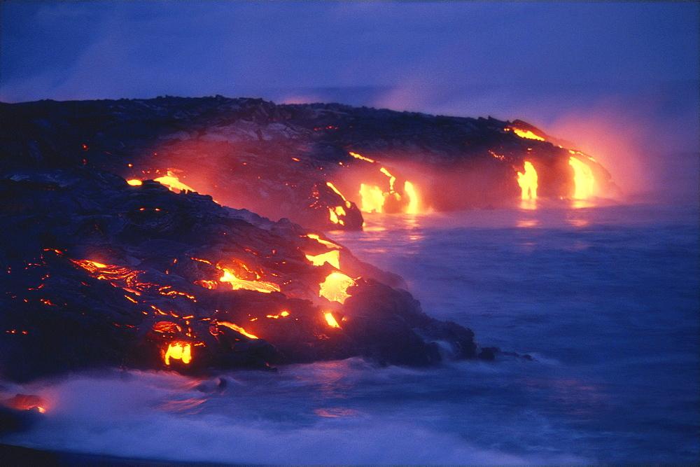 Hawaii, Big Island, Hawaii Volcanoes National Park, lava flow action into ocean twilight A27D