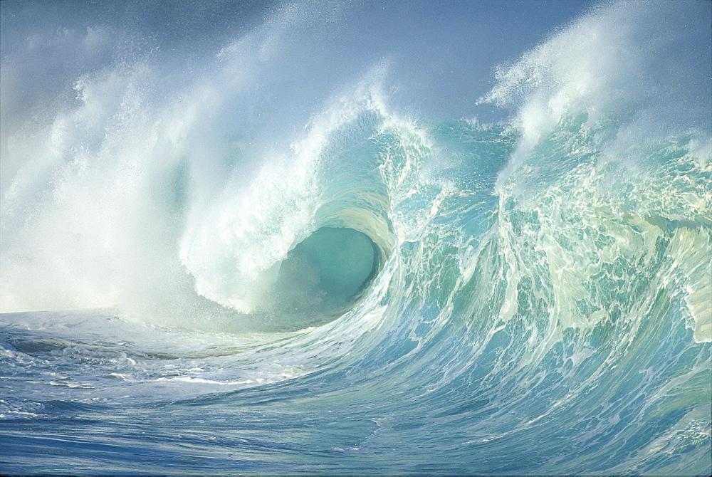 Huge wave curling, crashing side view of curl