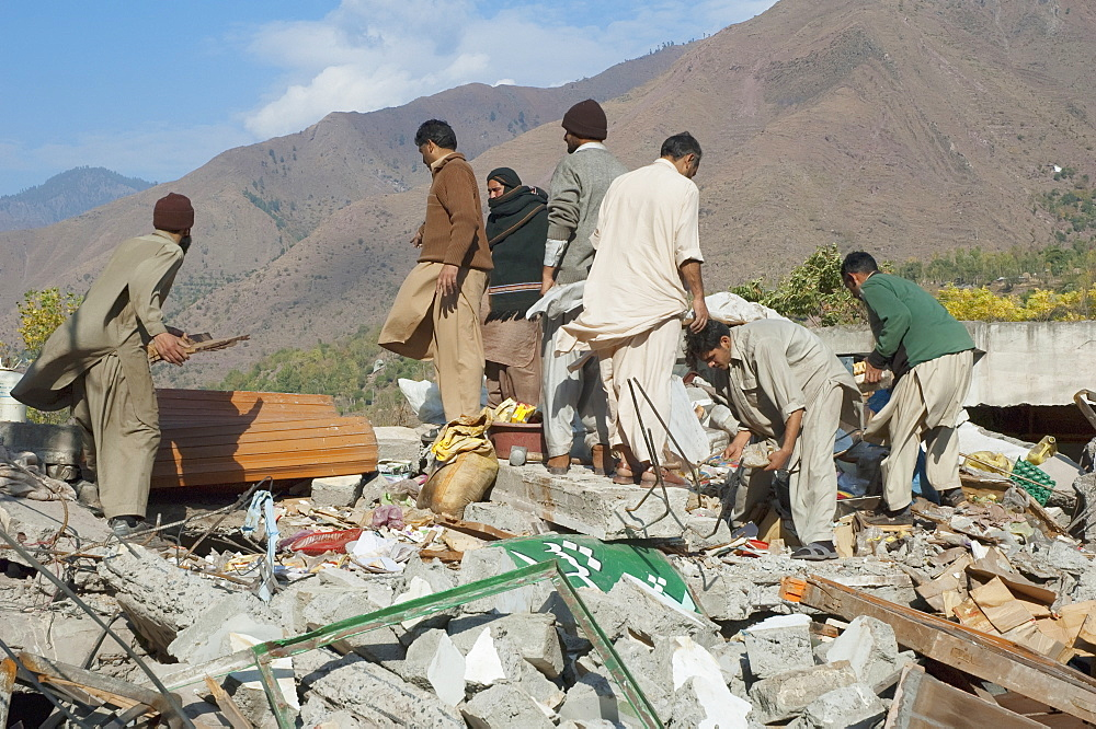 Men Digging For Corpses In The Ruins Of The Bazaar Destroyed By The 8 October 2005 Earthquake, Chinari, Azad Kashmir, Pakistan