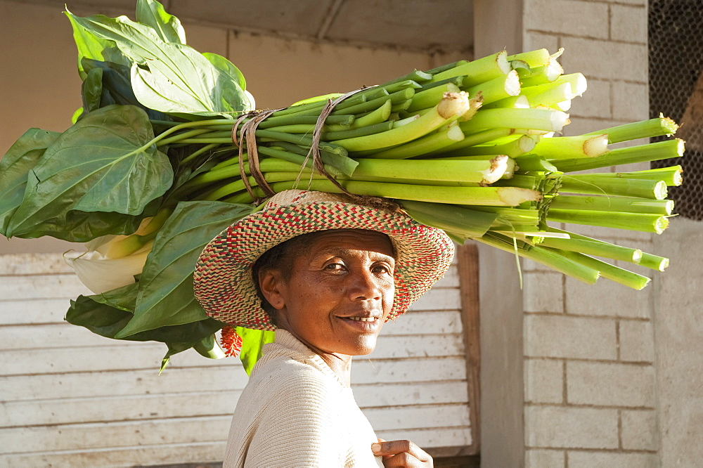 Woman Carrying Calla Lilies On Her Head In Fianarantsoa, Madagascar