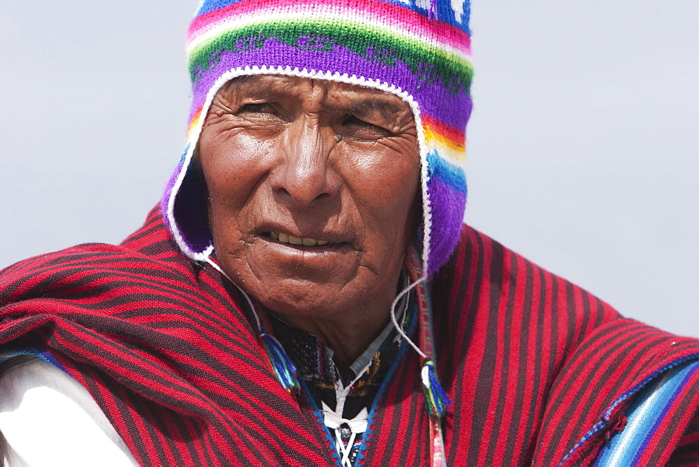 Yatiri (Aymara Healer) Performing An Ancient Sacrificial Burning Rite To Bring The Good Will Of The Goddess Pachamama (Mother Earth), Isla Del Sol In Titicaca Lake, La Paz Department, Bolivia