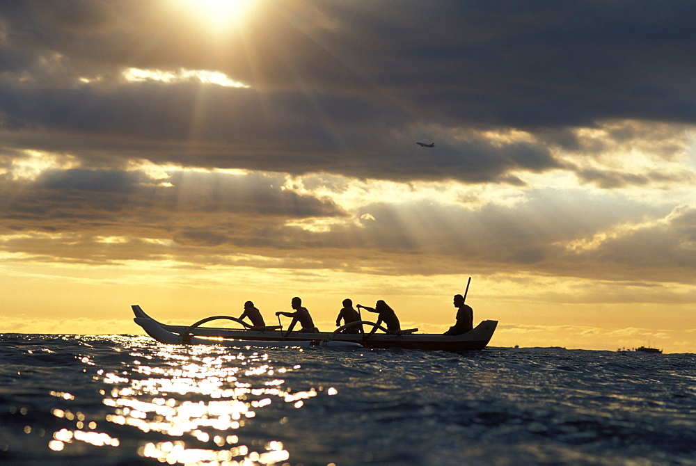 Hawaii, Outrigger Canoe, Silhouette At Sunset, Dramatic Sky, Golden Rays