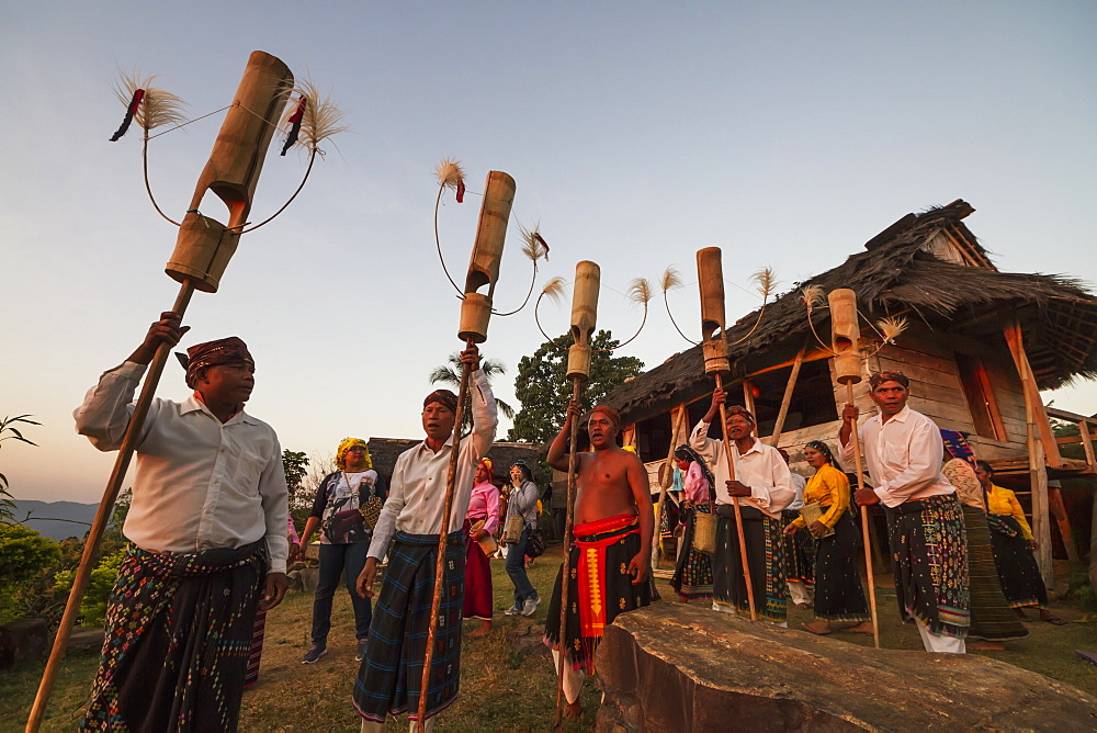 Manggarai men performing a traditional dance with poles, Melo village, Flores, East Nusa Tenggara, Indonesia
