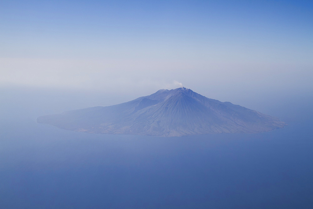 Aerial view of Sangeang Api Island with Sangeang Api Volcano, East Nusa Tenggara, Indonesia