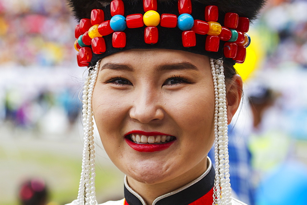 Woman in traditional Buryat dress at the 2014 Naadam Mongolian National Festival celebration by the National Sports Stadium, Ulaanbaatar (Ulan Bator), Mongolia