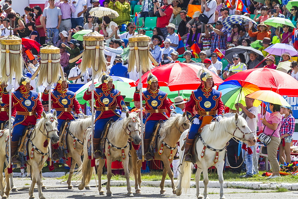 Honour guard in gala uniform riding on horseback carrying the Yesun Hult Tsagaan Tug (The Nine White Banners) at the opening ceremony of the 2014 Naadam Mongolian National Festival celebration in the National Sports Stadium, Ulaanbaatar (Ulan Bator), Mongolia