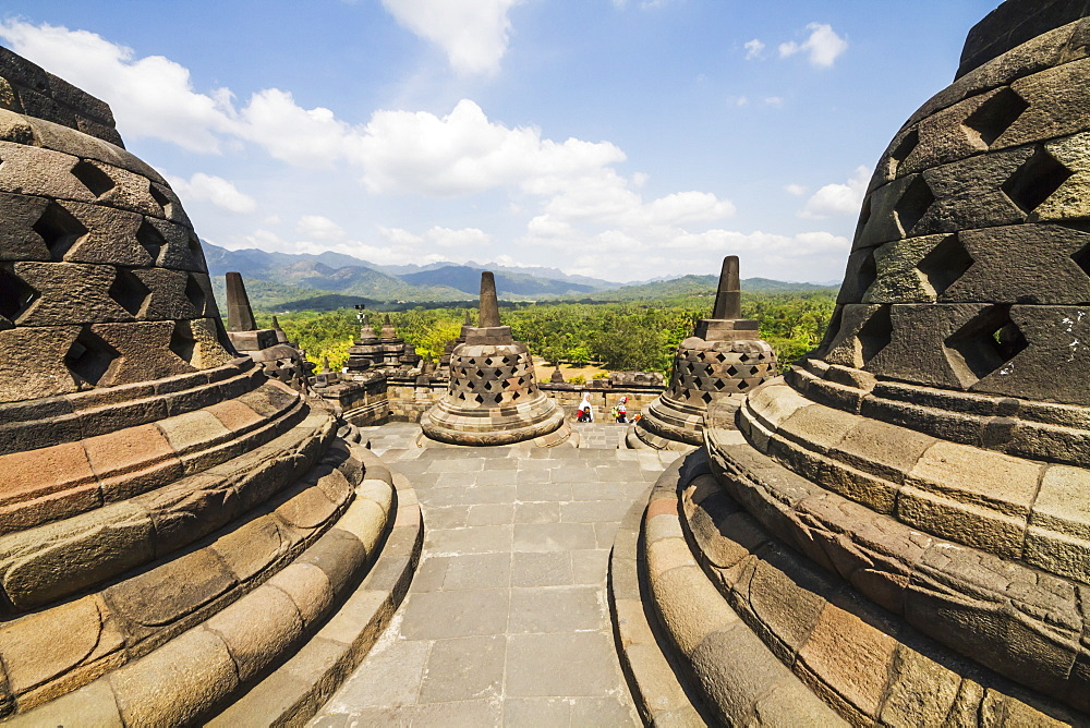 Latticed stone stupas containing Buddha statues on the upper terrace, Borobudur Temple Compounds, Central Java, Indonesia