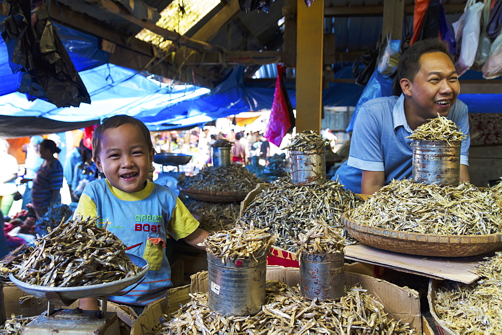 Father and son selling dried fish at the Bolu market, Makassar (Ujung Pandang), South Sulawesi, Indonesia