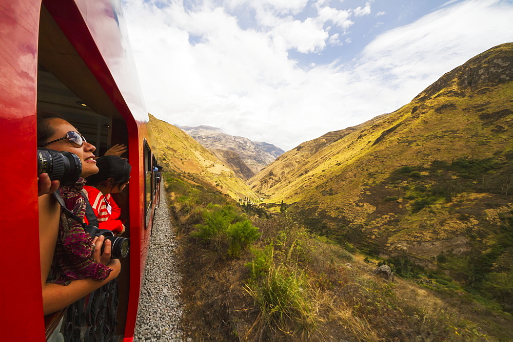 People on the viewing platform of the Observation car of the Tren Crucero train, Nariz del Diablo (Devil's Nose), Chimborazo, Ecuador