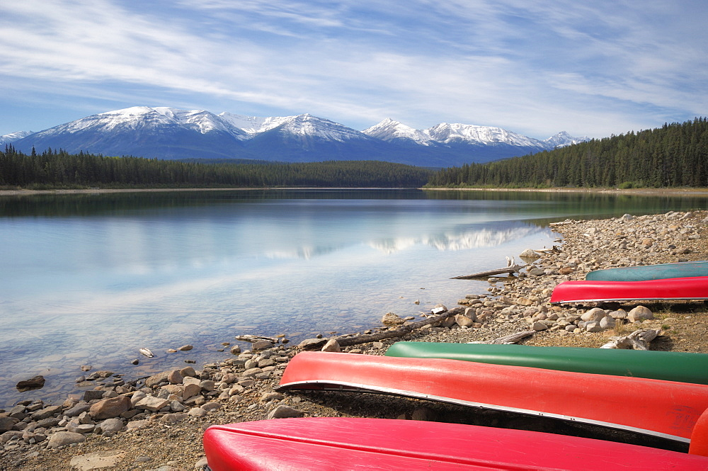 Canoes Along The Shore Of Patricia Lake - The Canadian Rocky Mountains, Jasper National Park, Alberta, Canada