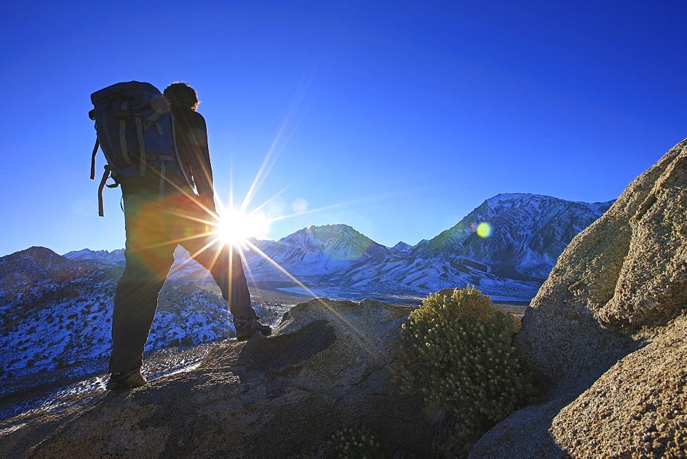 Hiker Standing In Bright Sun, Sierra Nevadas, California