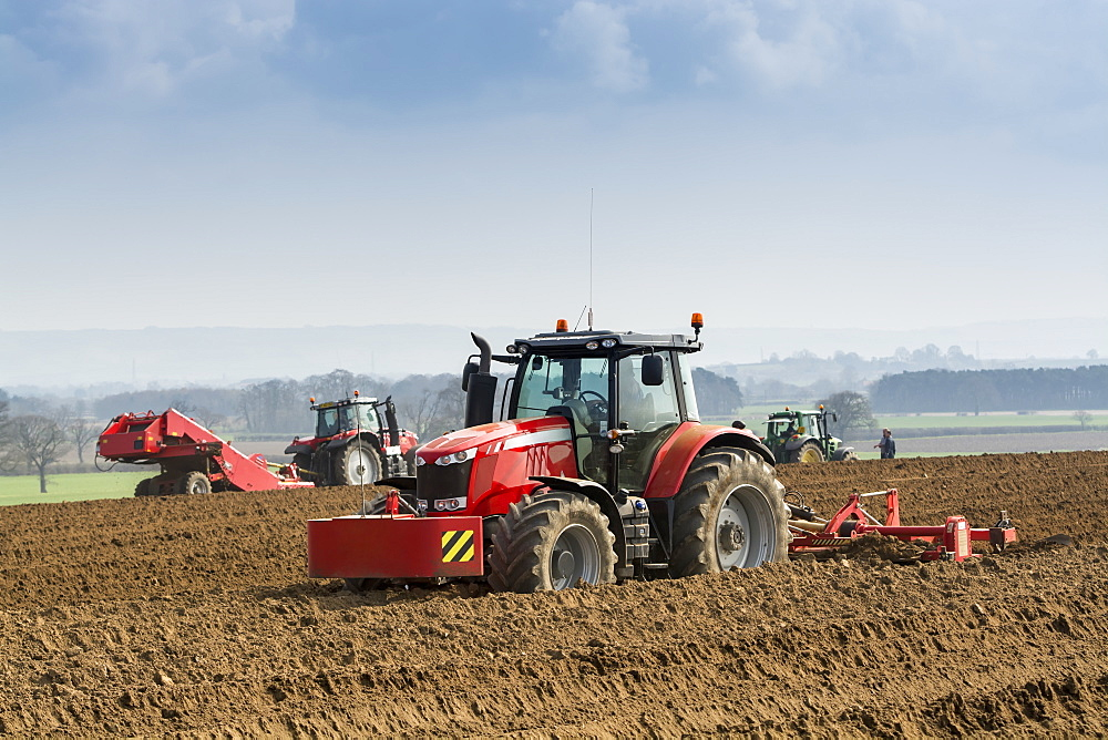 Making ridges for potato crop using a ridger pulled by a Massey Ferguson 7624, Yorkshire, England