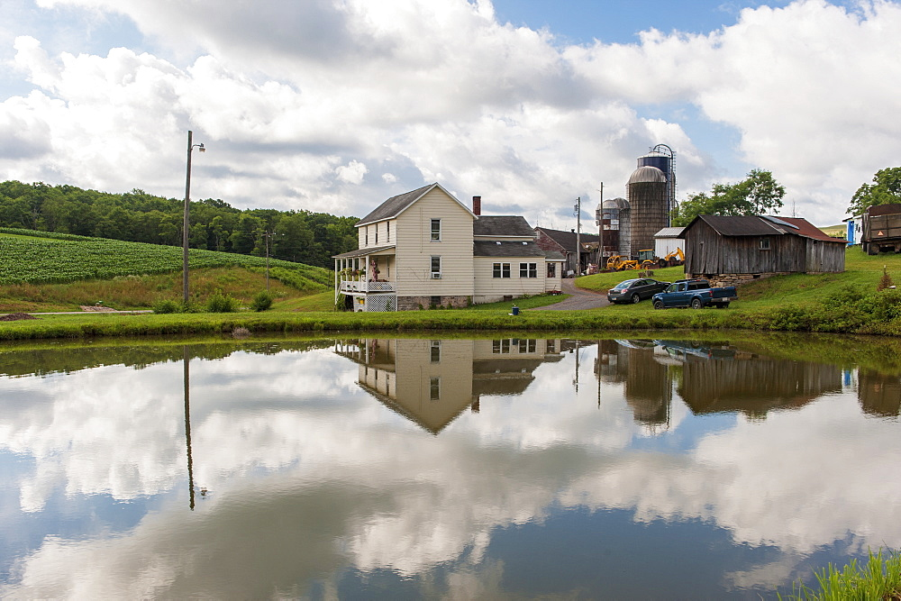 Reflections in pond of farm in Garrett County, Maryland, United States of America