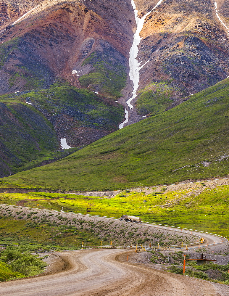 A semi-truck begins the ascent through Atigun Pass along the Dalton Highway; Alaska, United States of America