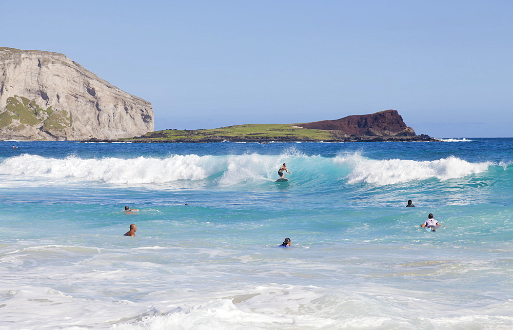 Bodyboarders catching waves at Makapu'u Beach; Waimanalo, Oahu, Hawaii, United States of America
