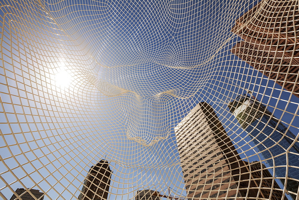 Calgary Skyline Viewed Through The Wonderland Sculpture; Calgary, Alberta, Canada