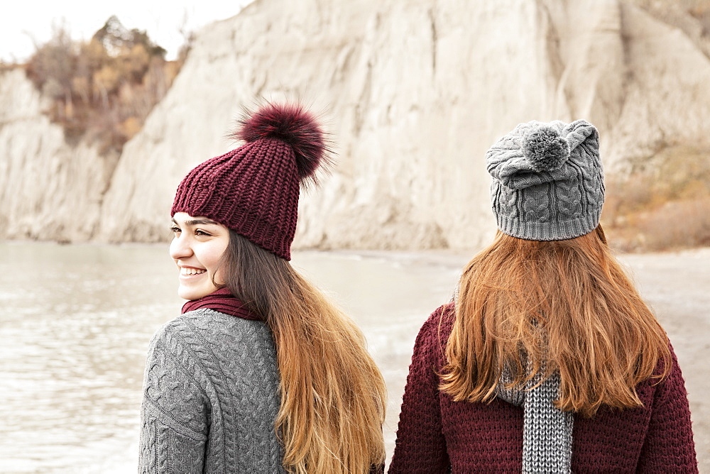 Close-up of two friends at the Scarborough Bluffs along Lake Ontario in autumn, Scarborough, Ontario, Canada