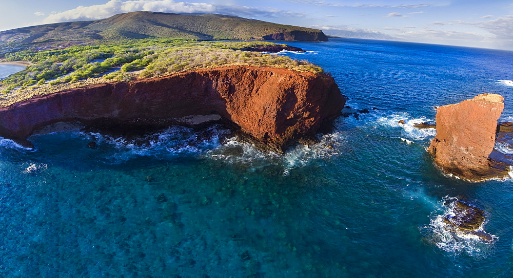 An aerial view of Puu Pehe Rock at sunset, also known as 'Sweetheart Rock', one of Lanai's most recognizable landmarks, Lanai, Hawaii, United States of America