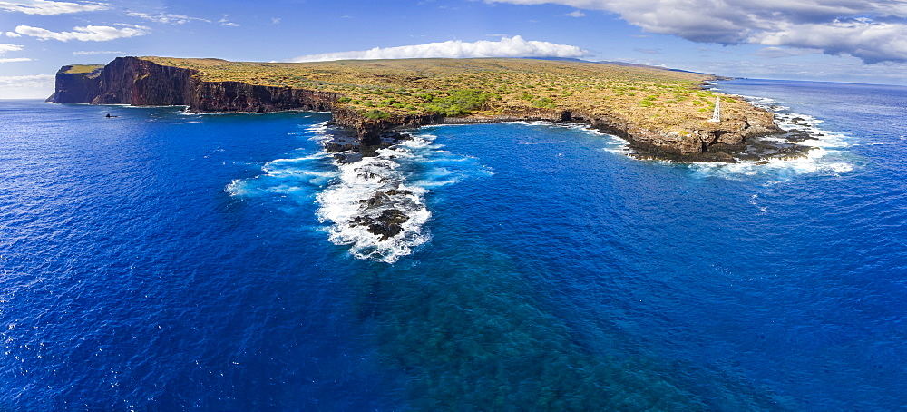 Cliffs along the coastline of the island of Lanai with bright blue ocean water, Lanai, Hawaii, United States of America