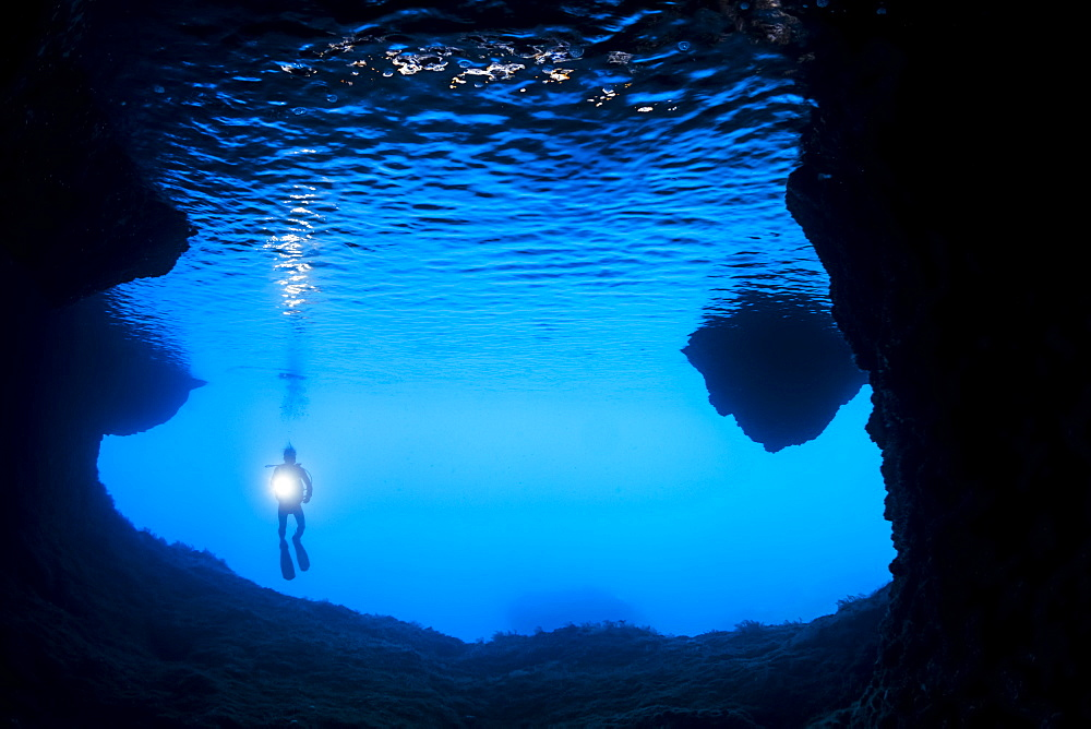 Diver at the entrance to a cavern off the island of Gato, Bohol Sea, Philippines - 1116-39759