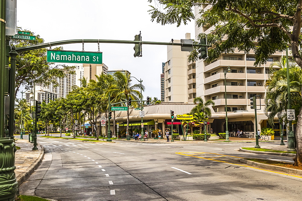 Westward view down Kuhio Avenue at the intersection with Namahana Street in Waikiki, Honolulu, Oahu, Hawaii, United States of America