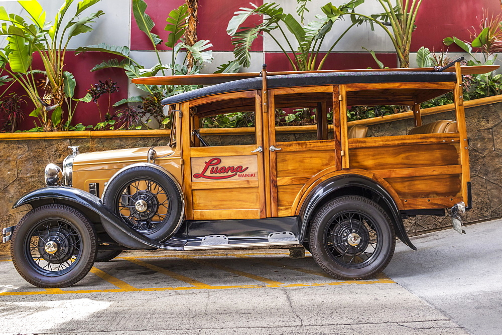 This 1930 Ford Model A Woody classic car is on display at the Luana Hotel, Waikiki, Honolulu, Oahu, Hawaii, United States of America