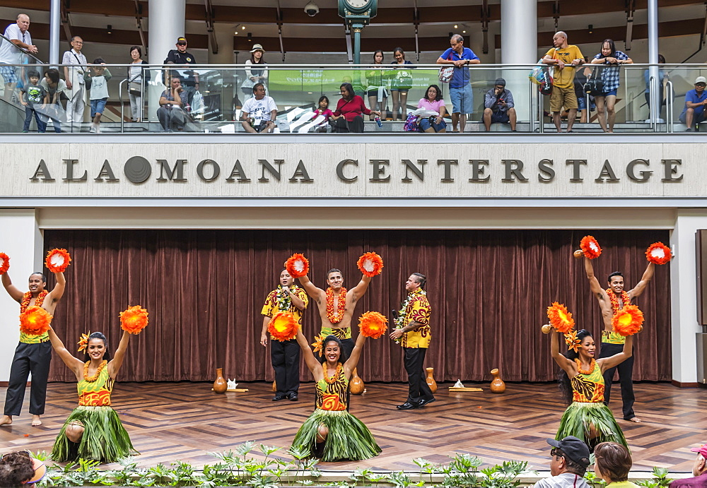 Hula dancers entertaining shoppers at the Ala Mona Shopping Center's stage in Waikiki, Honolulu, Oahu, Hawaii, United States of America