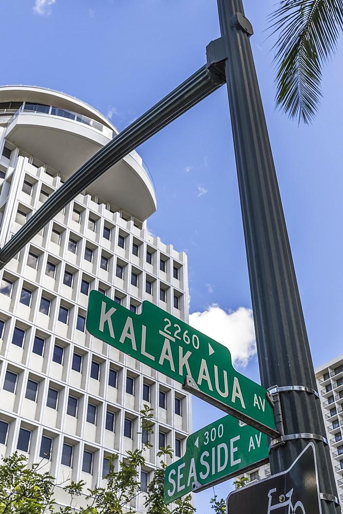 The Waikiki Busines Plaza towers over Waikiki near the intersection of Kalakaua and Seaside avenues, Honolulu, Oahu, Hawaii, United States of America