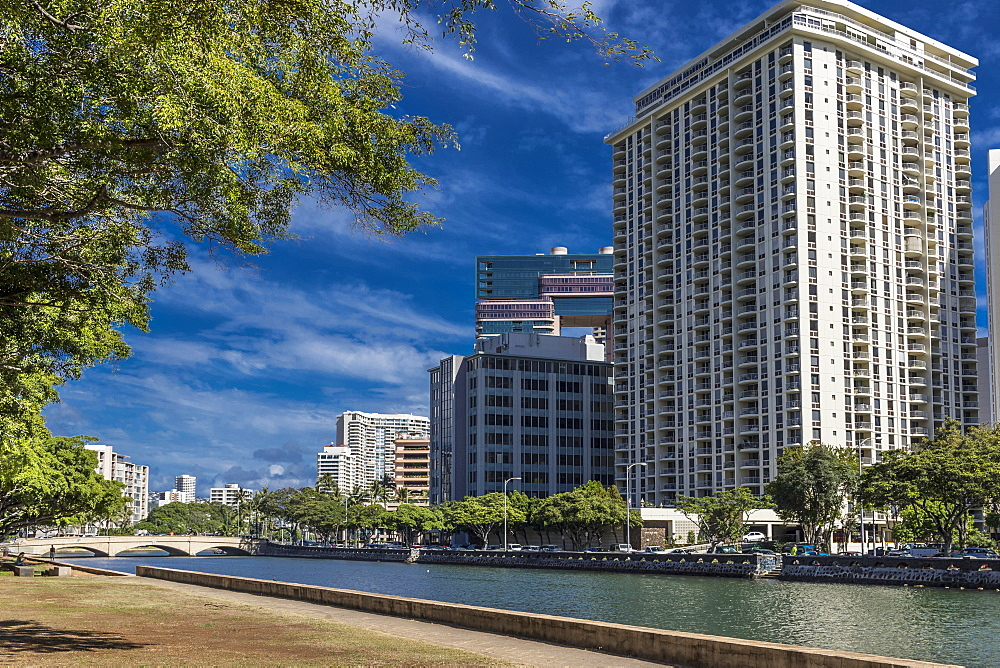 View North across Ala Wai Canal from Ala Wai Promenade towards Kalakaua Avenue bridge, Waikiki, Honolulu, Oahu, Hawaii, United States of America