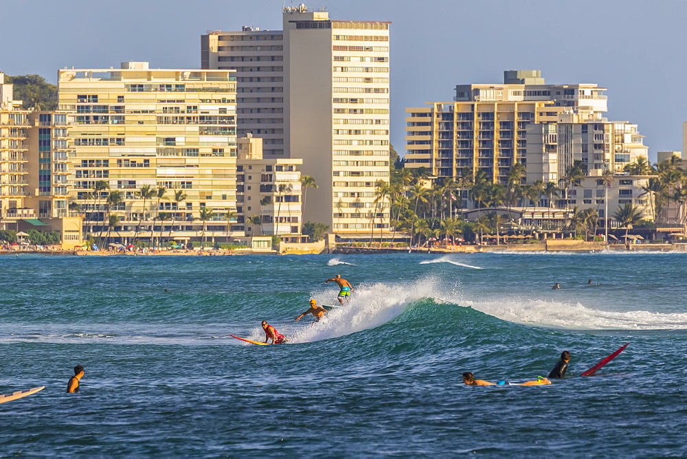 Surfing at Waikiki viewed from Magic Island, Ala Moana Beach Park, Honolulu, Oahu, Hawaii, United States of America