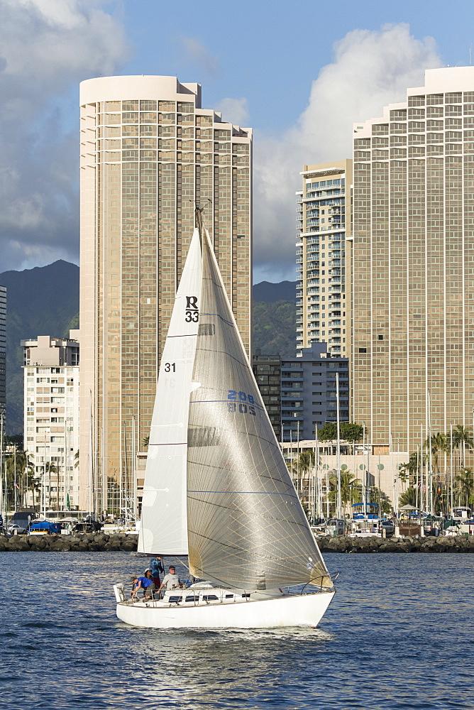 Sailing from the Ala Wai boat harbor, Waikiki, Honolulu, Oahu, Hawaii, United States of America