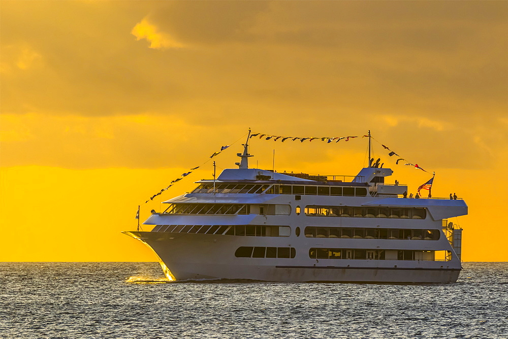 Star of Honolulu making a sunset cruise viewed from Magic Island, Ala Monana beach park, Honolulu, Oahu, Hawaii, United States of America