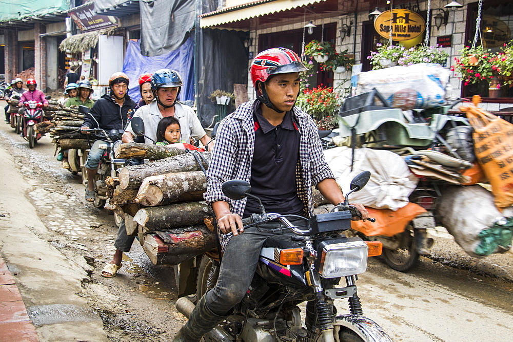 People hauling logs on motorbikes, Sapa, Lao Cai, Vietnam